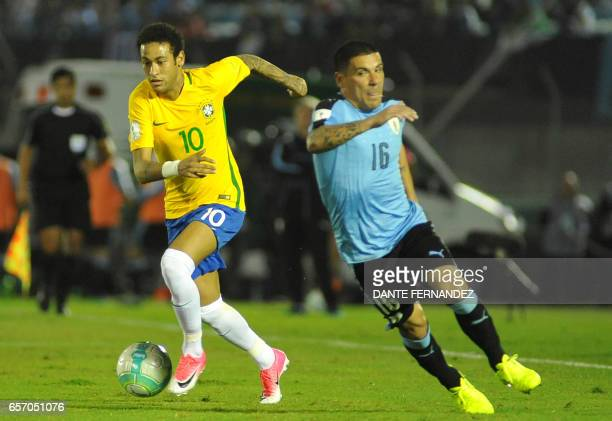 Brazil's forward Neymar vies for the ball with Uruguay's Maximiliano Pereira during their 2018 FIFA World Cup qualifier football match in the...