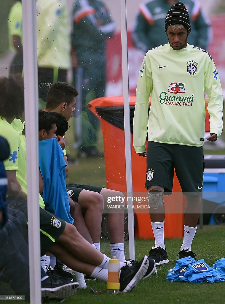 Brazil's forward Neymar, wearing a bandage on his knee, attends a training session at the Granja Comary training complex in Teresopolis during the 2014 FIFA World Cup football tournament on July 1, 2014.