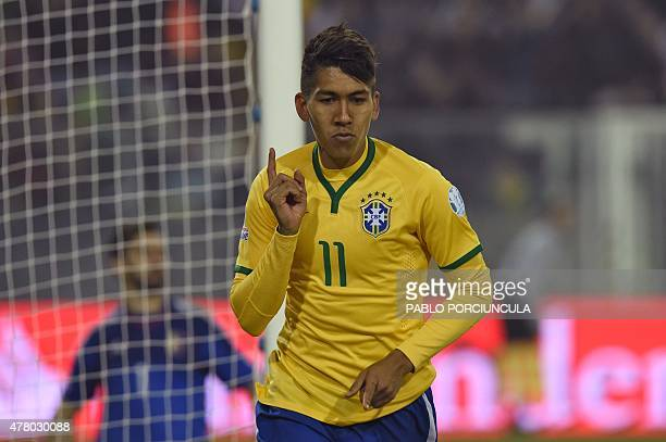 Brazil's forward Roberto Firmino celebrates after scoring the team's second goal against Venezuela during their 2015 Copa America football...