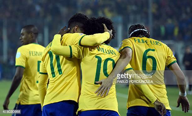 Brazil's forward Roberto Firmino celebrates with teammates after scoring against Venezuela during their 2015 Copa America football championship match...