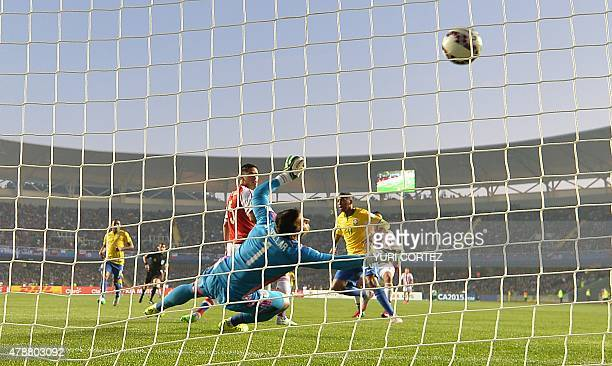 Brazil's forward Robinho scores past Paraguay's goalkeeper Justo Villar during their 2015 Copa America football championship quarterfinal match in...