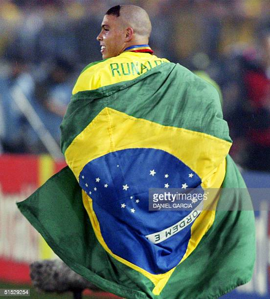 Brazil's forward Ronaldo celebrates after his team defeated Germany 20 in the final match of the 2002 FIFA World Cup Korea Japan at International...