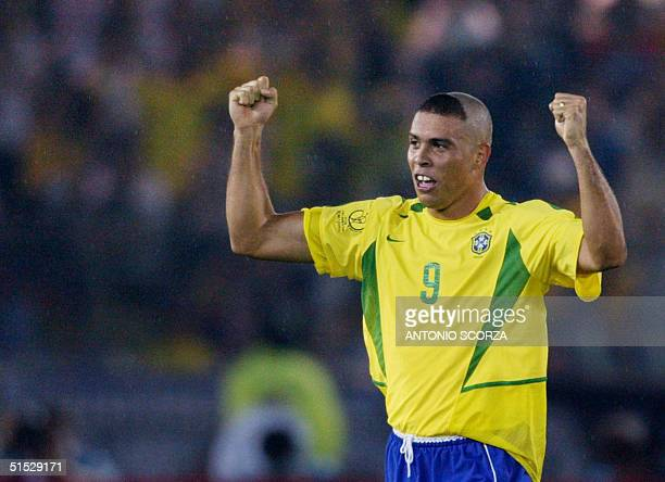 Brazil's forward Ronaldo celebrates after scoring the first goal against Germany during match 64 of the 2002 FIFA World Cup Korea Japan final 30 June...