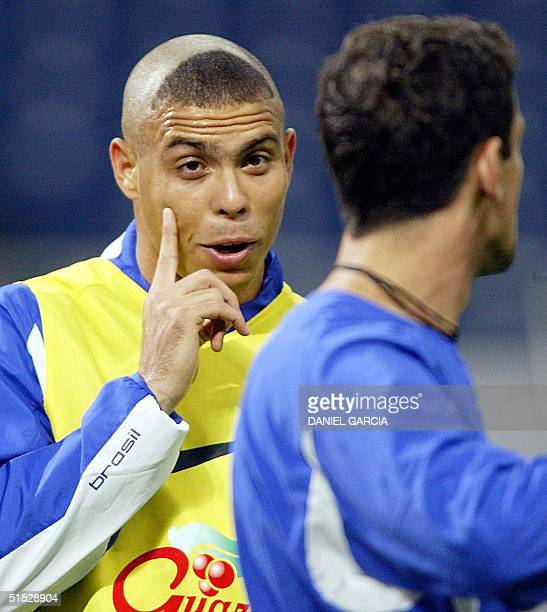 Brazil's forward Ronaldo Nazario jokes with Edmilson 24 June 2002 during an afternoon training session at Saitama stadium Turkey pose a bigger threat...