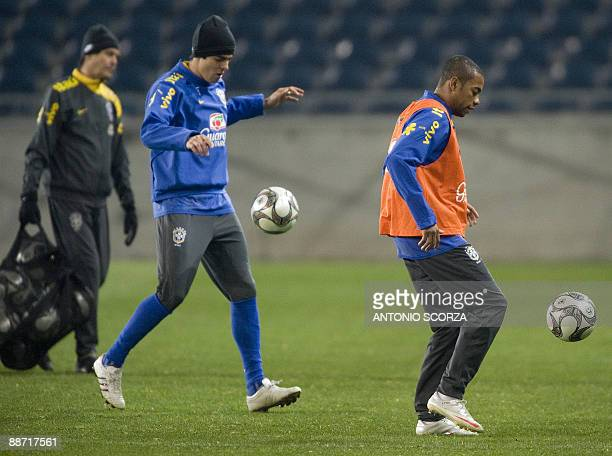 Brazil's forwards Kaka and Robinho control the ball before leaves the pitch after the practices at Orlando Stadiumon June 27 2009 in Soweto...