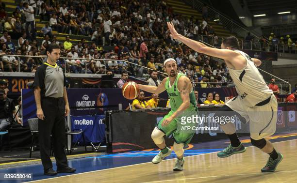 Brazil's Fulvio Chianta de Assis drives the ball marked by Mexico's Hector Hernandez during their 2017 FIBA Americas Championship game in Medellin...
