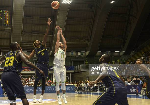 Brazil's Fulvio Chianta de Assis shoots against Colombia's Braian Angola during their 2017 FIBA Americas Championship game in Medellin Colombia on...