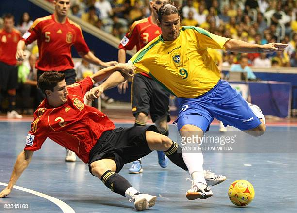 Brazil's futsal player Betao vies for the ball with Spain's Ortiz on October 19 2008 during their FIFA Futsal World Cup final match at Maracanazinho...