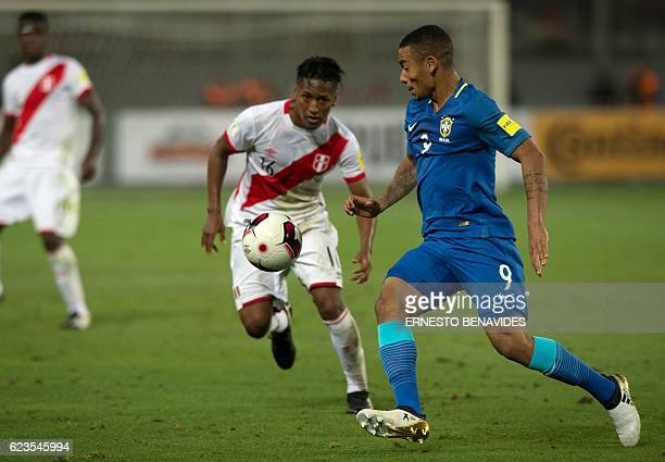 Brazil's Gabriel Jesus and Peru's Pedro Aquino eye the ball during their 2018 FIFA World Cup qualifier football match in Lima on November 15 2016 /...