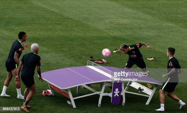 TOPSHOT Brazil's Gabriel Jesus Dani Alves Neymar and Phillippe Coutinho take part in a trainig session at the Sao Paulo FC training center in Sao...