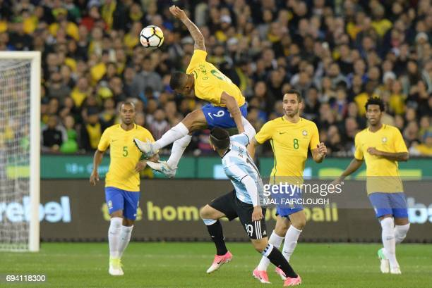 Brazils Gabriel Jesus flying over Argentinas Ever Banega during the friendly international football match between Brazil and Argentina at the MCG in...