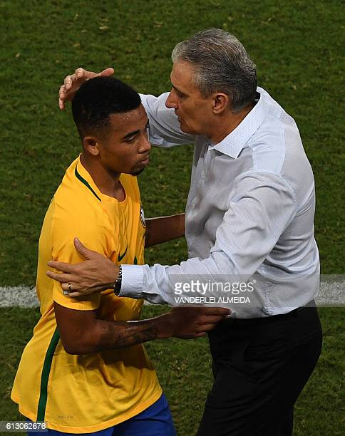 Brazil's Gabriel Jesus is embraced by Brazilian coach Tite during their Russia 2018 World Cup qualifier football match against Bolivia in Natal...