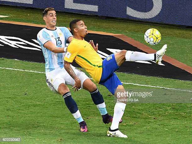 Brazil's Gabriel Jesus is marked by Argentina's Ramiro Funes Mori during their 2018 FIFA World Cup qualifier football match in Belo Horizonte Brazil...