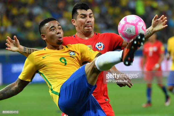 Brazil's Gabriel Jesus is marked by Chile's Gary Medel during their 2018 World Cup football qualifier match in Sao Paulo Brazil on October 10 2017 /...