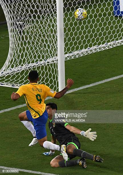 Brazil's Gabriel Jesus scores against Bolivia's goalkeeper Carlos Lampe during their Russia 2018 World Cup qualifier football match in Natal Brazil...