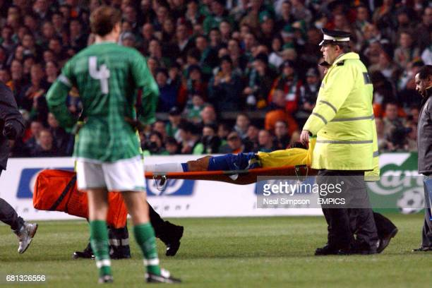 Brazil's Gilberto Silva is carried off the field on a stretcher after a challenge from Ireland's Graham Kavanagh