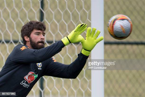 Brazil's goalkeeper Alisson takes part in a training session of the national football team at the Granja Comary sports complex in Teresopolis about...