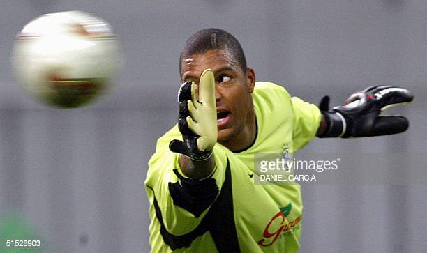 Brazil's goalkeeper Dida dives trying to stop the ball 24 June 2002 during the afternoon training session at Saitama Stadium Brazil will face Turkey...