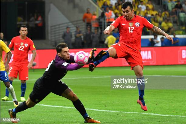 Brazil's goalkeeper Ederson and Chile's Gary Medel vie for the ball during their 2018 World Cup football qualifier match in Sao Paulo Brazil on...