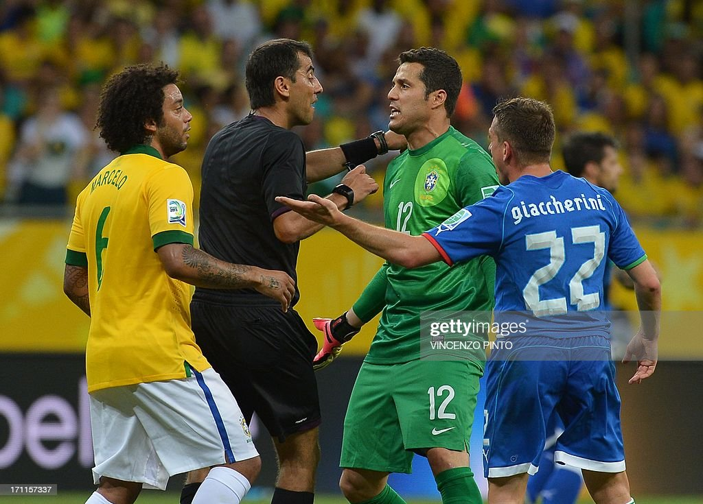 Brazil's goalkeeper Julio Cesar (2-R) and Italy's midfielder Emanuele Giaccherini (R) talk to Uzbek referee Ravshan Irmatov (2-L) as Brazil's defender Marcelo (L) listens during their FIFA Confederations Cup Brazil 2013 Group A football match, at the Fonte Nova Arena in Salvador, on June 22, 2013. Brazil won 4-2.
