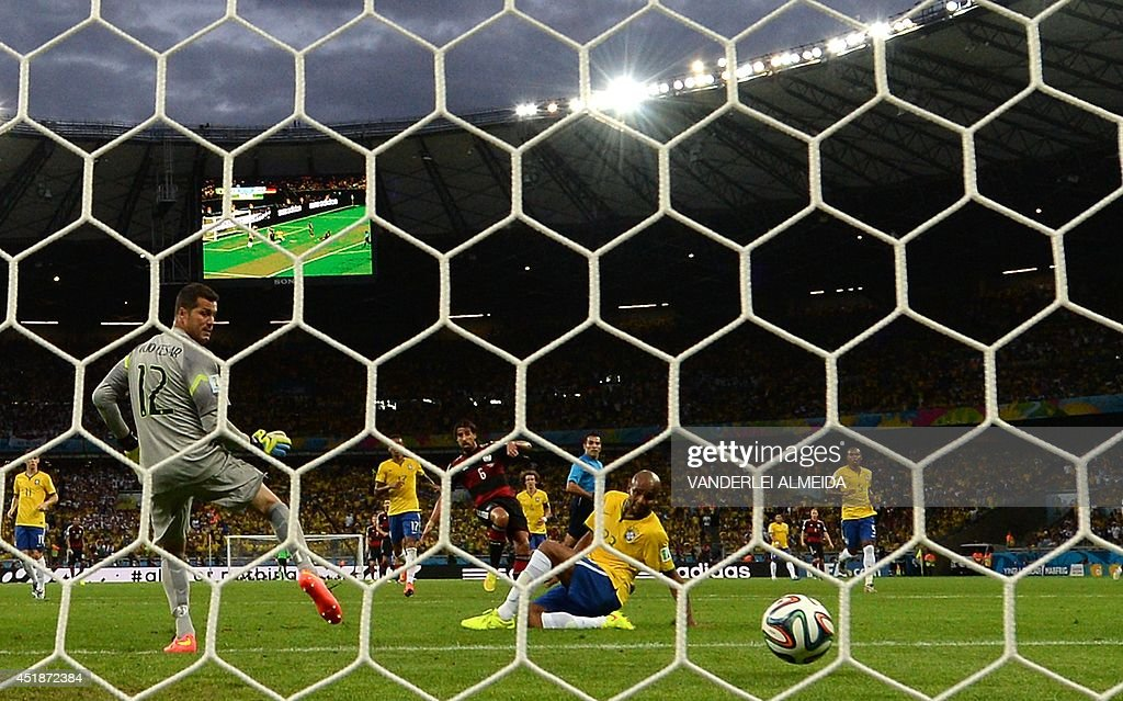 Brazil's goalkeeper Julio Cesar (L) concedes a goal yo Germany's midfielder Sami Khedira (back C) during the semi-final football match between Brazil and Germany at The Mineirao Stadium in Belo Horizonte during the 2014 FIFA World Cup on July 8, 2014. Germany won 7-1.