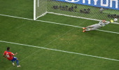 Brazil's goalkeeper Julio Cesar dives to save a penalty kick by Chile's defender Gonzalo Jara during the penalty shootout after the extra time in the...