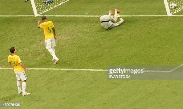 Brazil's goalkeeper Julio Cesar fails to save a goal as Brazil's midfielder Fernandinho and Brazil's midfielder Hernanes react during the third place...
