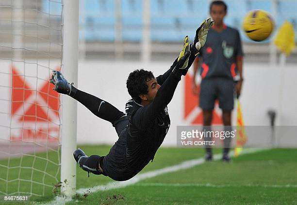 Brazil's goalkeeper Renan Ribeiro dives during a penalty shot kicked by Colombia's Hernan Pertuz during their U20 South American Championship...