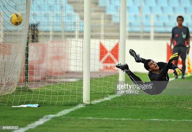 Brazil's goalkeeper Renan Ribeiro fails to stop a penalty shot kicked by Colombia's Hernan Pertuz during their U20 South American Championship...