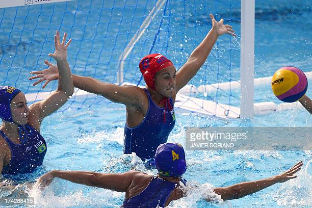 Brazil's goalkeeper Victoria Chamorro tries to stop a shot during the preliminary round match between Kazakhstan and Brazil of the women's water polo...