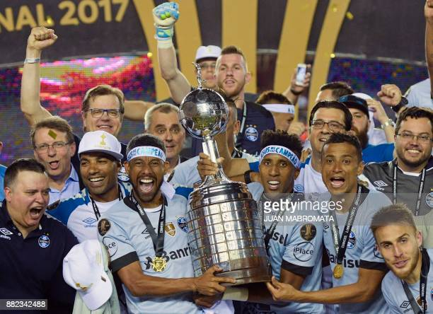 TOPSHOT Brazil's Gremio celebrate with the trophy after winning the Copa Libertadores 2017 final football match against Argentina's Lanus at Lanus...