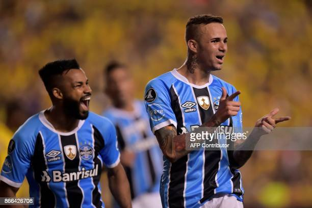 Brazil's Gremio Luan celebrates with Fernandinho his goal against Ecuador's Barcelona during the 2017 Libertadores Cup football match at Monumental...