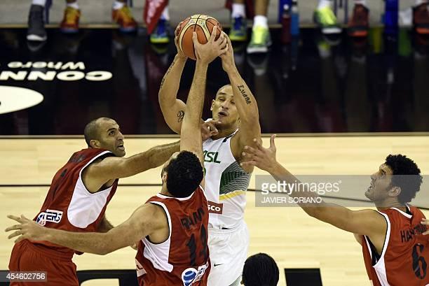 Brazil's guard Leandrinho Barbosa vies with Egypt's guard Wael Badr Egypt's forward Ramy Ibrahim and Egypt's centre Haytham Khamal during the 2014...