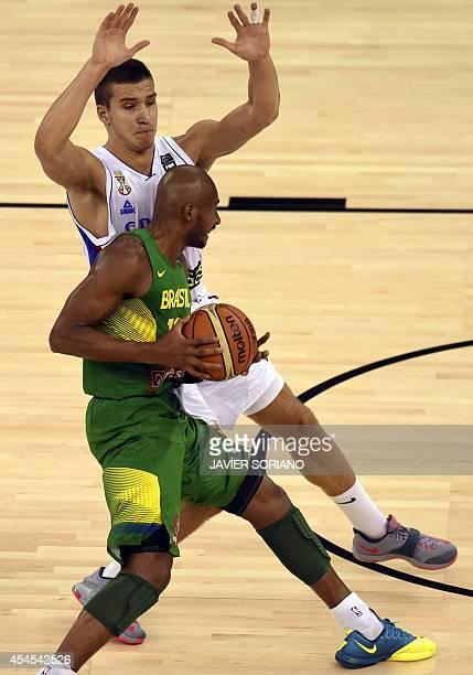Brazil's guard Leandrinho Barbosa vies with Serbia's guard Bogdan Bogdanovic during the 2014 FIBA World basketball championships group A match Serbia...