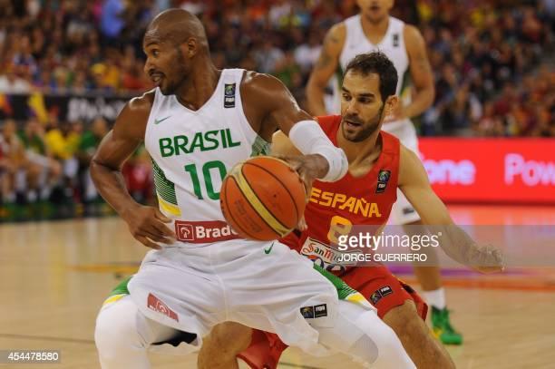 Brazil's guard Leandrinho Barbosa vies with Spain's guard Jose Calderon during the 2014 FIBA World basketball championships group A match Brazil vs...