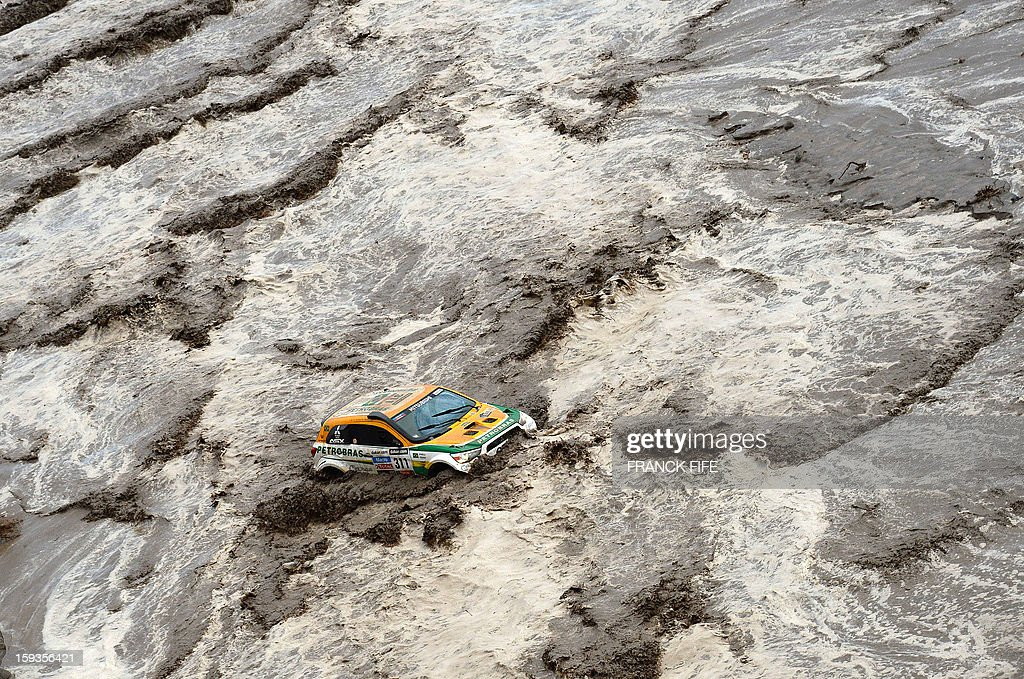 Brazil's Guilherme Spinelli is seen stuck in a flooded river during Stage 8 of the Dakar Rally 2013 between Salta and Tucuman, Argentina, on January 12, 2013. The rally takes place in Peru, Argentina and Chile from January 5-20. AFP PHOTO / FRANCK FIFE