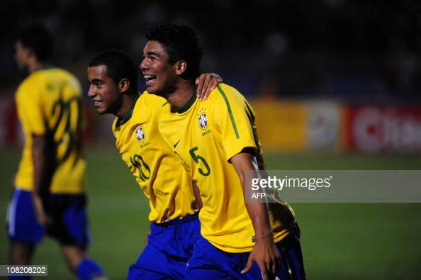 Brazil´s halfback Carlos Casimiro celebrates with teammates after scooring against Colombia during their Under20 South American championship match at...