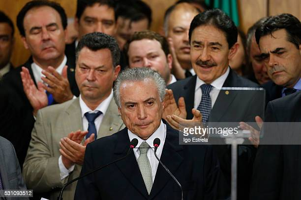 Brazil's interim President Michel Temer attends a signing ceremony for new government ministers at the Planalto presidential palace after the Senate...