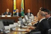Brazil's interim President Michel Temer presides the first ministers meeting at the Planalto Palace in Brasilia between Chief of Staff Eliseu Padilha...