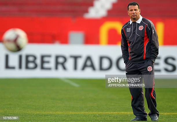 Brazil's Internacional football team coach Celso Roth looks at his players at the end of the training session held behind closed doors at Beira Rio...