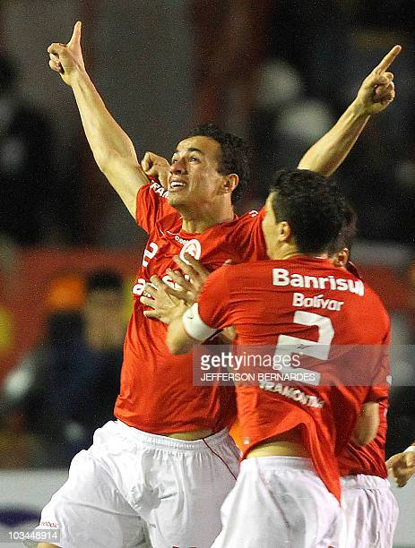 Brazil's Internacional footballer Leandro Damiao celebrates with teammates after scoring against Chivas of Mexico during their Libertadores Cup final...