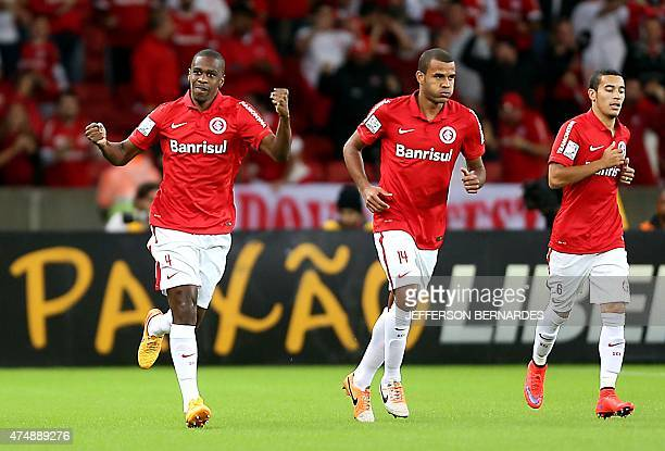 Brazil's Internacional Juan celebrates next to teammates his goal against Colombia's Santa Fe during their Copa Libertadores football match at Beira...