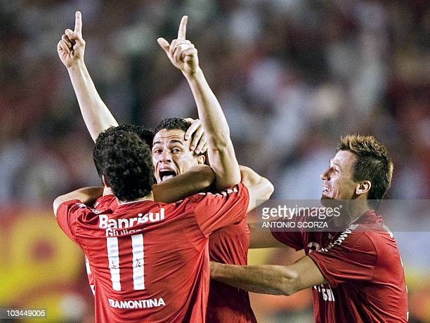 Brazil's Internacional player Leandro Damiao celebrates with teammates his goal against Mexico's Chivas on August 18 2010 during their Libertadores...