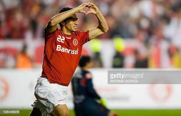 Brazil's Internacional soccer player Leandro Damiao celebrates his goal against Mexico's Chivas on August 18 2010 during their Libertadores final...