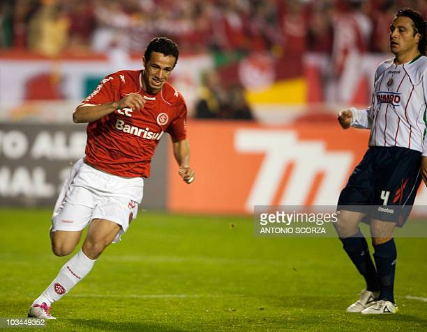 Brazil's Internacional soccer player Leandro Damiao celebrates his goal before Mexico's Chivas Hector Lopez on August 18 2010 during their...