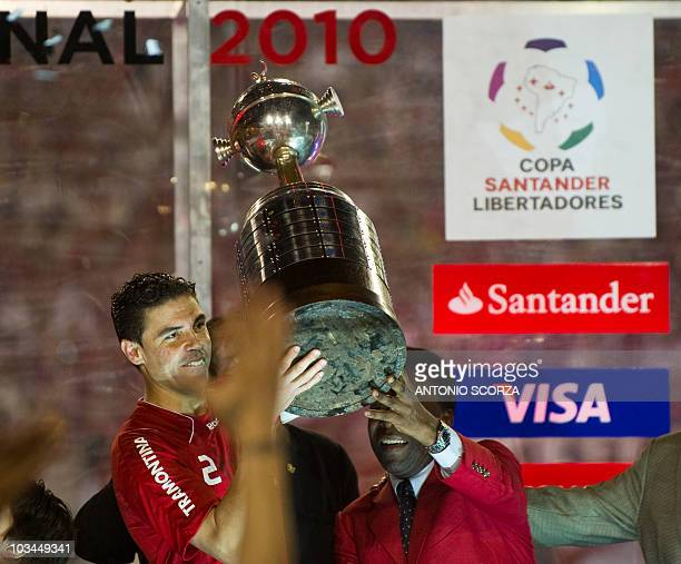 Brazil's Internacional team captain Bolivar holds the Libertadores Cup with soccer legend Pele after defeating Mexico's Chivas 32 on August 18 2010...