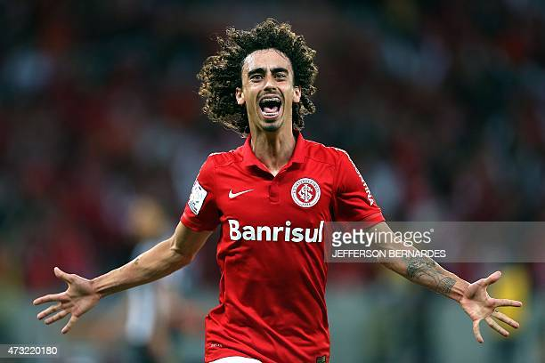 Brazil's Internacional Valdivia celebrates his goal against Brazil's Atletico Mineiro during their Copa Libertadores football match at Beira Rio...