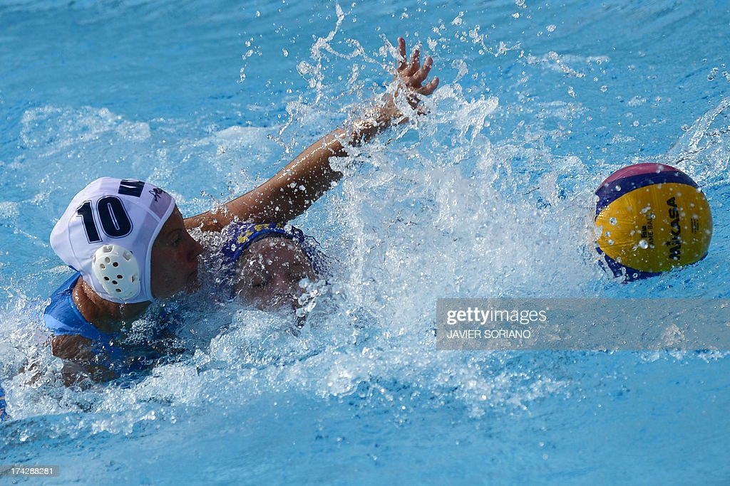 Brazil's Izabella Chiappini (R) vies with Kazakhstan's Marina Gritsenko (L) during the preliminary round match between Kazakhstan and Brazil of the women's water polo competition at the FINA World Championships in Bernat Picornell pools in Barcelona on July 23, 2013. AFP PHOTO / JAVIER SORIANO
