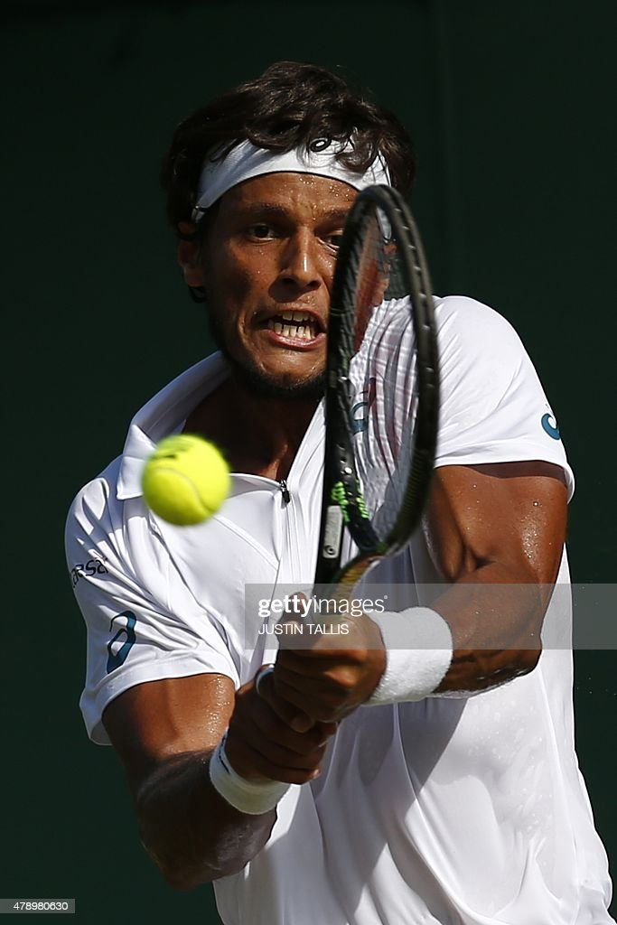Brazil's <a gi-track='captionPersonalityLinkClicked' href=/galleries/search?phrase=Joao+Souza+-+Brazilian+Tennis+Player&family=editorial&specificpeople=7935783 ng-click='$event.stopPropagation()'>Joao Souza</a> returns against Colombia's Santiago Giraldo during their men's singles first round match on day one of the 2015 Wimbledon Championships at The All England Tennis Club in Wimbledon, southwest London, on June 29, 2015. RESTRICTED