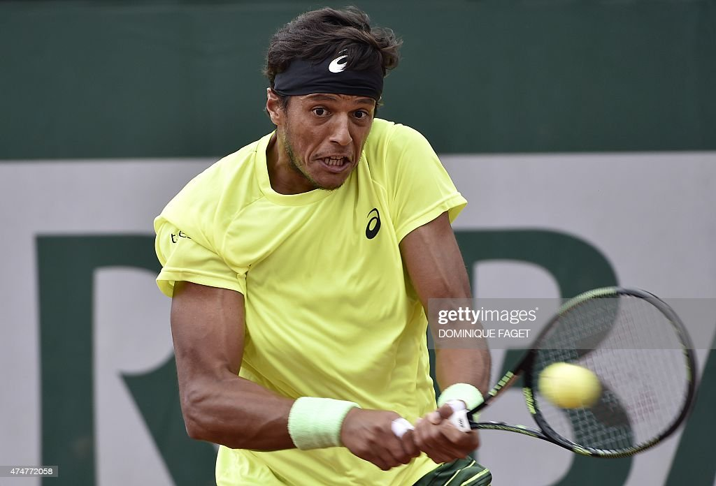 Brazil's <a gi-track='captionPersonalityLinkClicked' href=/galleries/search?phrase=Joao+Souza+-+Brazilian+Tennis+Player&family=editorial&specificpeople=7935783 ng-click='$event.stopPropagation()'>Joao Souza</a> returns the ball to Spain's Daniel Gimeno-Traver during the men's first round of the Roland Garros 2015 French Tennis Open in Paris on May 26, 2015.